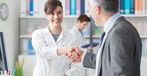 doctor shaking hands with member